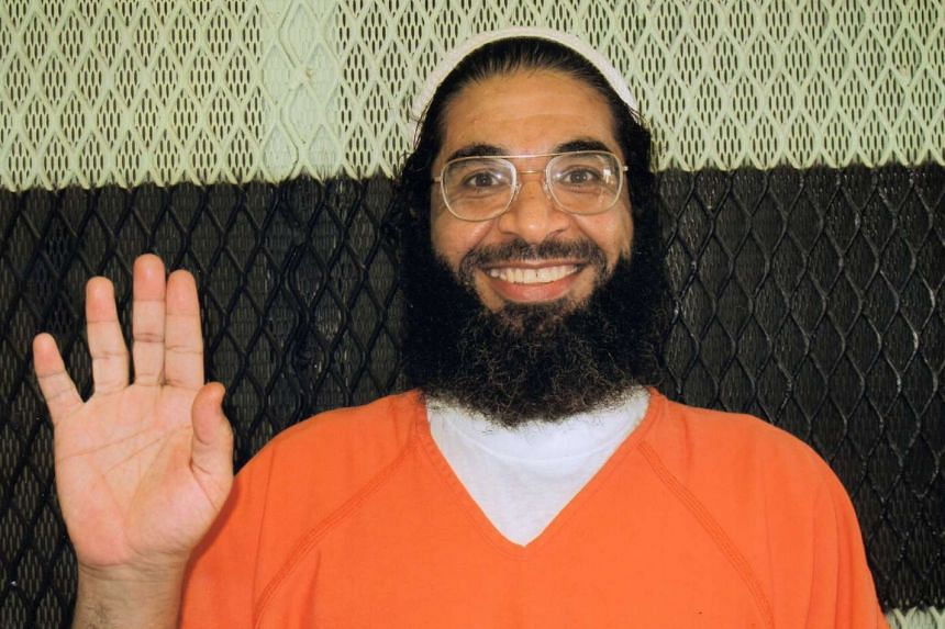 British national Shaker Aamer waves after spending 13 years at the US military prison in Cuba.