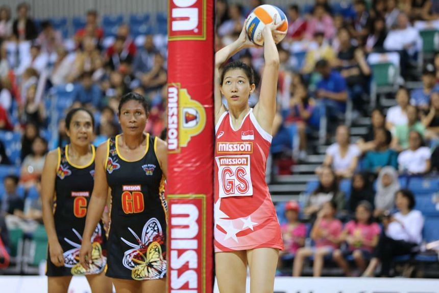 Team Singapore's Charmaine Soh takes a shot to bring the host nation a point closer to equalizing with Papua New Guinea at the 10th Mission Foods Nations Cup on Dec 13, 2015.