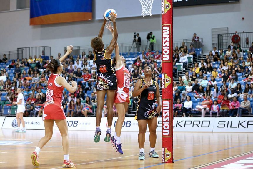 Papua New Guinea's Kilala Sunema Owen intercepts a pass to Singapore's Pamela Liew at the 10th Mission Foods Nations Cup on Dec 13, 2015.
