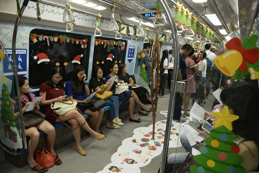 Passengers in a Christmas-themed train along the North South MRT Line on Dec 14, 2015.