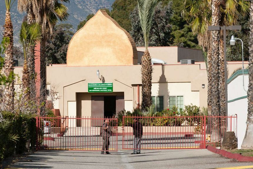 Two men close a gate outside the Dar Al Uloom Al Islamiyah of America Mosque in California on Dec 5, 2015.