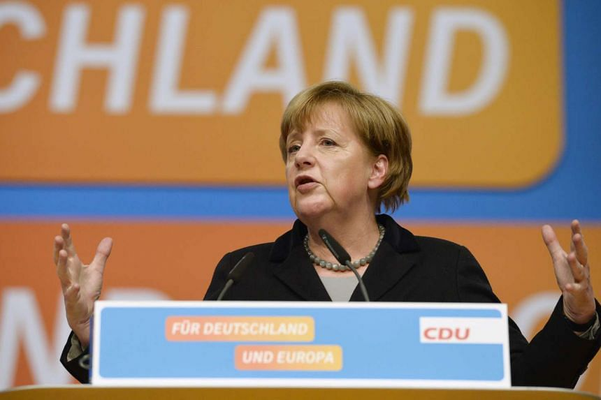 German chancellor Angela Merkel pledged to stem a massive refugee influx but rebuffed calls to slamt the door shut.
