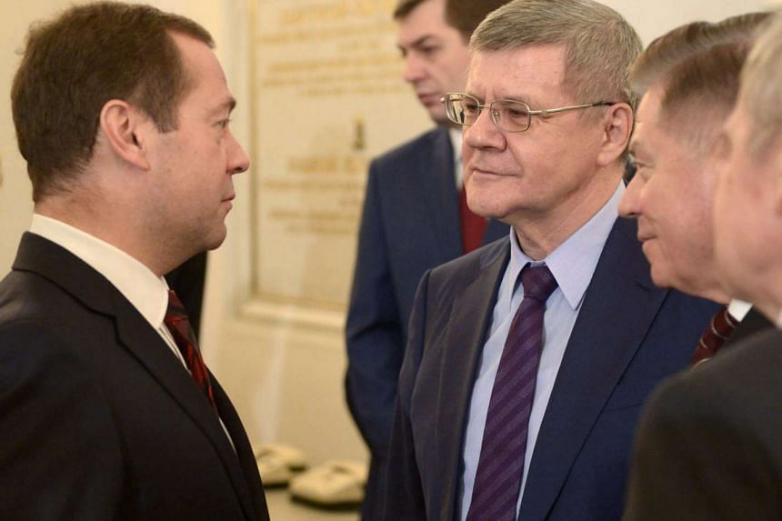 Russian Prime Minister Dmitry Medvedev (left) and Russian Prosecutor General Yury Chaika (centre) speak  to Russian President Vladimir Putin on Dec 3, 2015.