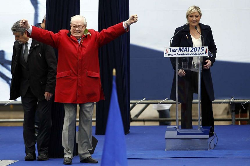 France's far-right political party Front National founder Jean-Marie Le Pen (in red) during the party's annual rally on May 1, 2015.