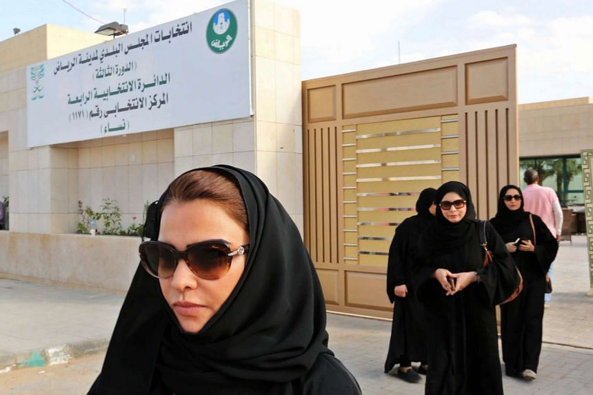 Saudi women leave a polling station after casting their votes in Riyadh, Saudi Arabia.