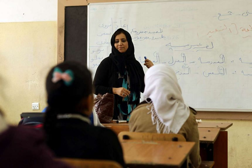 Libyan students attend a class at the al-Bashayer school in the eastern coastal city of Benghazi on Dec 13, 2015, as they come back to school for the first time since August 2014 when Islamist-backed militias seized Tripoli, prompting the internation