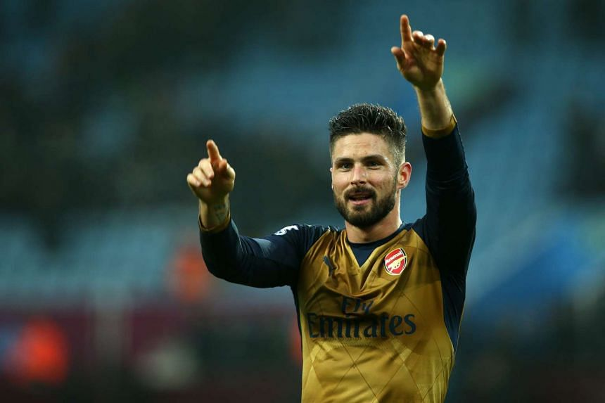 Arsenal's Olivier Giroud applauds the supporters during the English Premier League football match between Aston Villa and Arsenal.