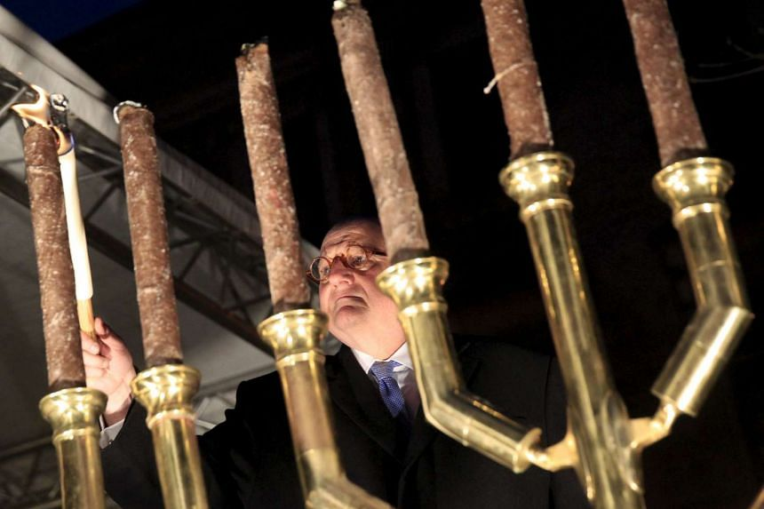Ira Forman, US. Special Envoy of the Office to Monitor and Combat Anti-Semitism, lights a menorah during a protest organised by a Jewish group against a planned statue of Balint Homan in Szekesfehervar, Hungary, on Dec 13, 2015.