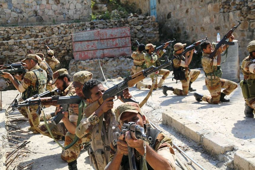 Soldiers loyal to Yemen's government during a training exercise in Taiz on Dec 13, 2015.