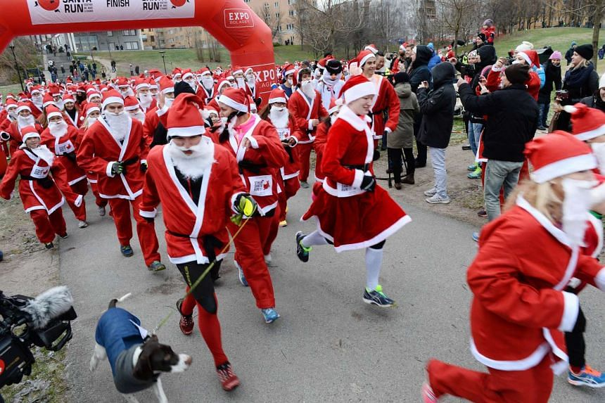 Participants dressed up as Santa Claus take part in the three kilometres long charity event Santa Claus Run in Stockholm on Dec 13, 2015.