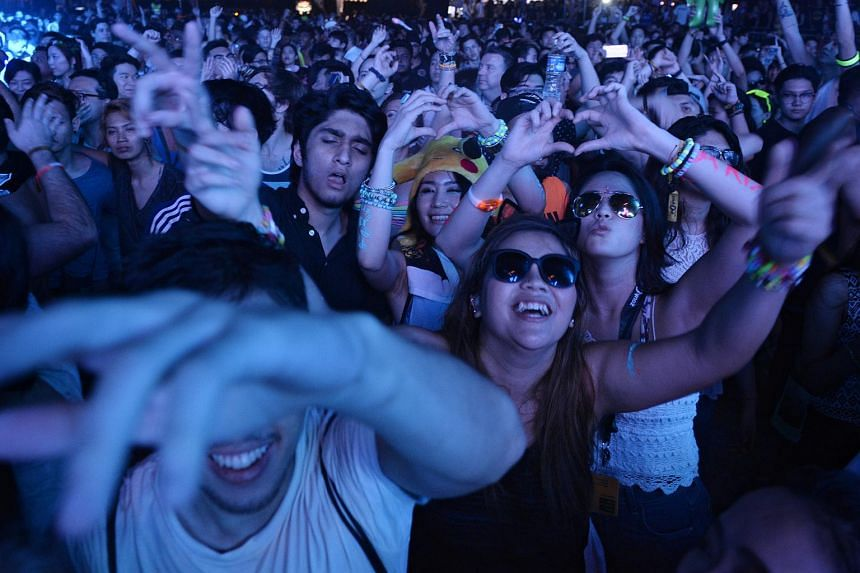 Party goers pictured during Kaskade's set at the first day of ZoukOut.