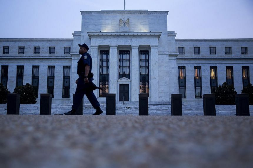 A Federal Reserve police officer walks past the Marriner S. Eccles Federal Reserve building in Washington.
