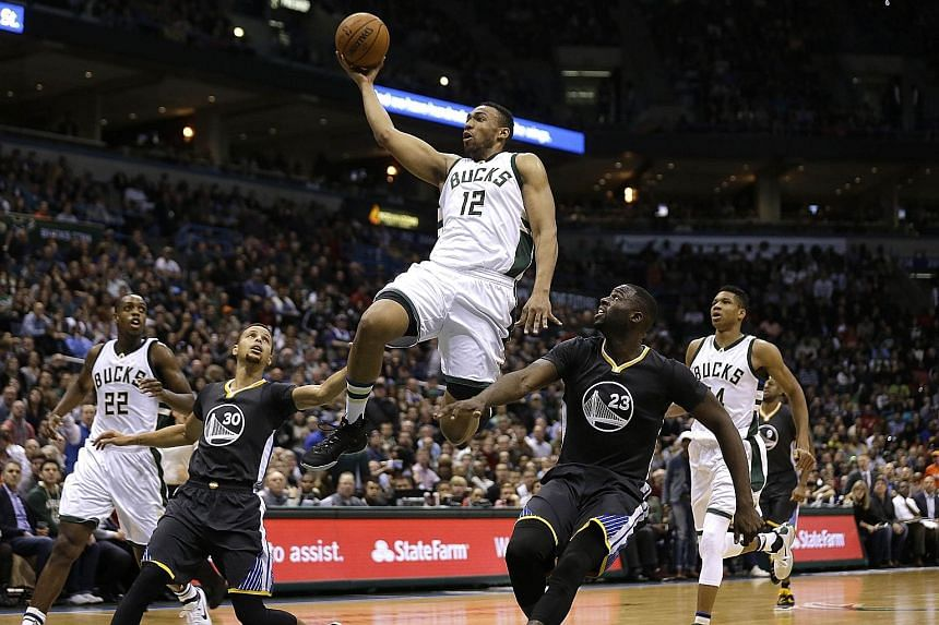 Milwaukee Bucks forward Jabari Parker driving to the hoop in the match against the Golden State Warriors at the weekend.