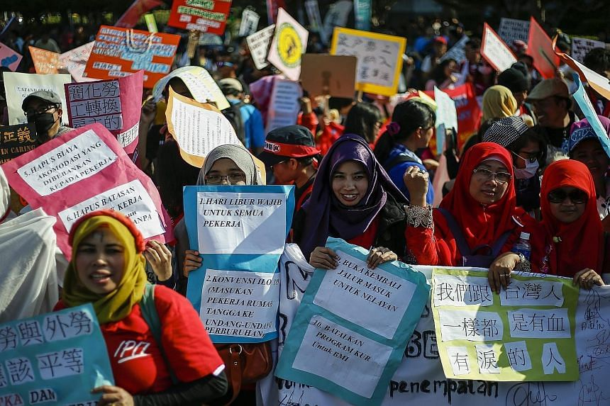 Migrant workers and domestic helpers from around Asia taking part in a protest yesterday in Taipei, near the Presidential Office Building. More than 1,000 protesters from Indonesia, the Philippines, Thailand and Vietnam demanded justice, equality and