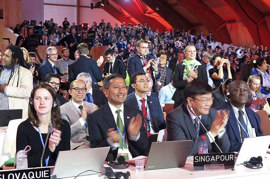 Foreign Minister Vivian Balakrishnan (foreground, second from left) at the World Climate Change Conference 2015 in Paris. He acknowledged that the deal was not perfect but, for the first time, the world has a climate pact in which all nations would p