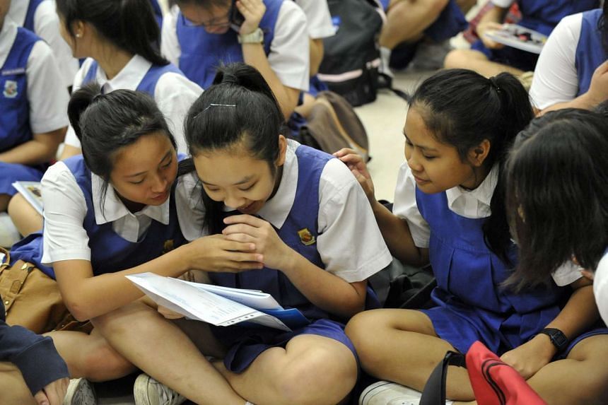 CHIJ St Theresa's Convent students receiving their N-level examination results on Dec 19, 2011.