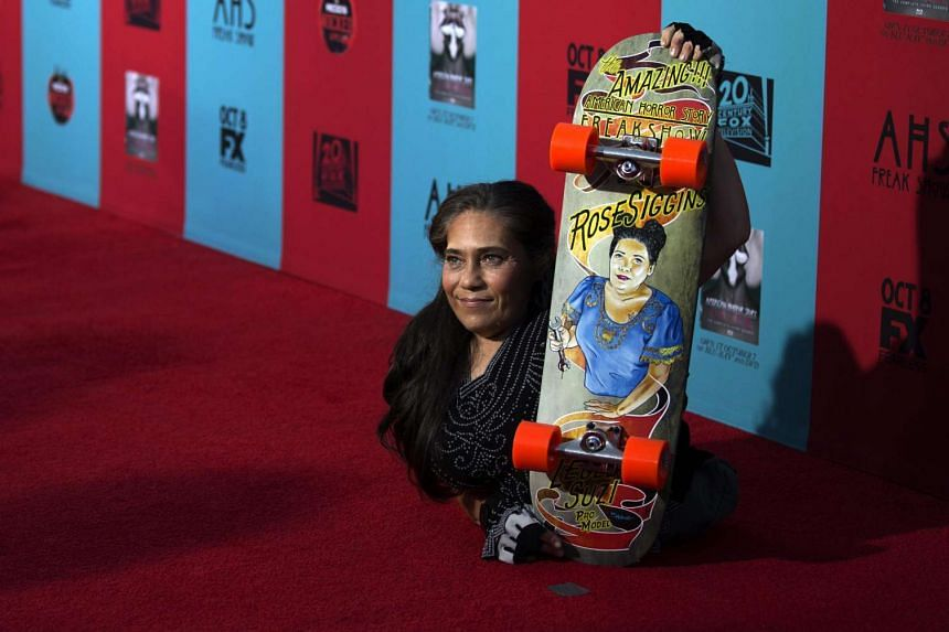 Rose Siggins poses with her skateboard at the premiere of American Horror Story: Freak Show in Hollywood on Oct 5, 2014.