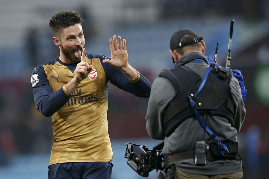 Arsenal's Olivier Giroud celebrates at the end of the match against Aston Villa on Sunday.
