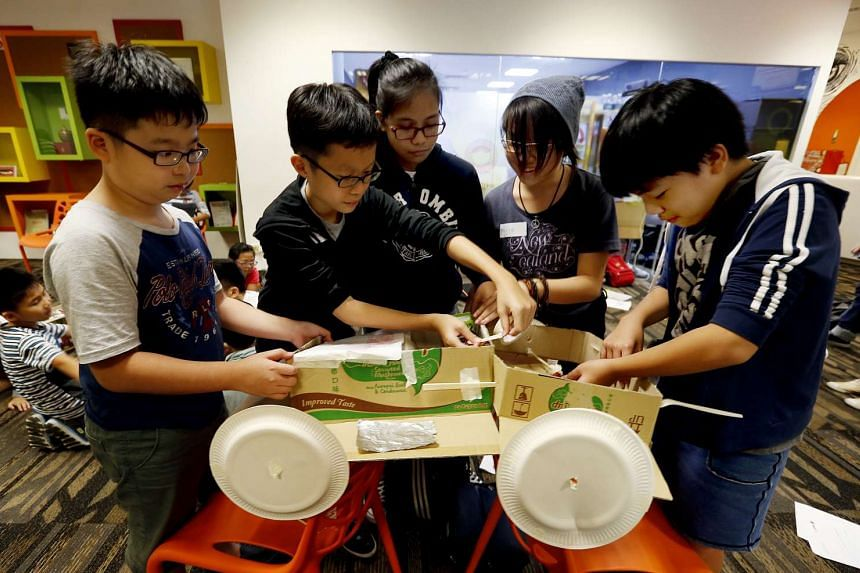 Close to 80 children of GrabCar and GrabTaxi drivers here attended a one-day workshop, where they imagined and built, from scrap materials, a car in the year 2064. The workshop is part of GrabSchool, a pilot initiative that aims to get young ones thinking