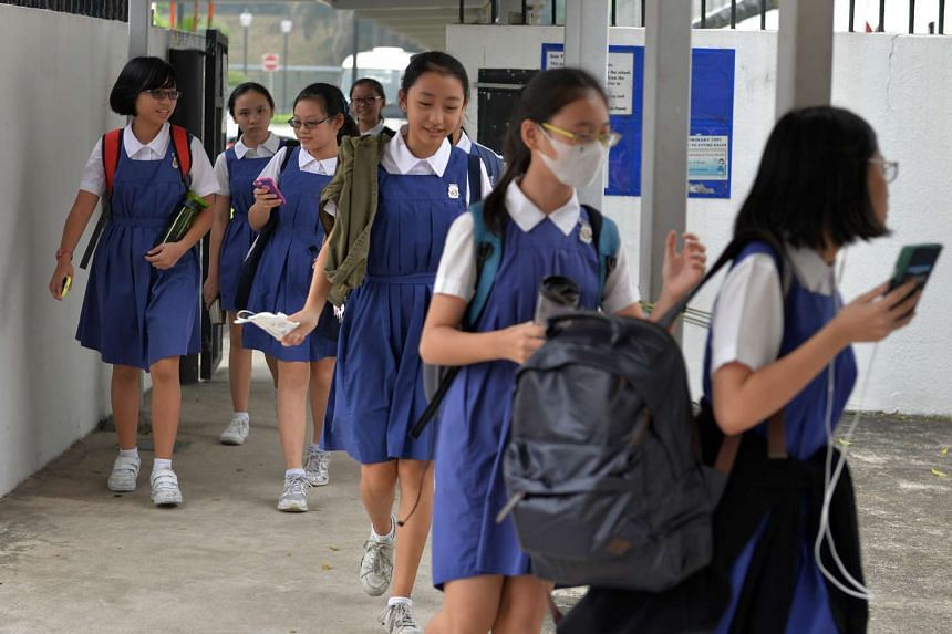 Primary 6 pupils from CHIJ Primary (Toa Payoh) leaving after their PSLE exams on Oct 1.
