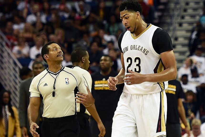 Anthony Davis #23 of the New Orleans Pelicans speaks with referee Bill Kennedy #55 (left) at the Smoothie King Centre on Oct 31, 2015 in New Orleans, Louisiana.