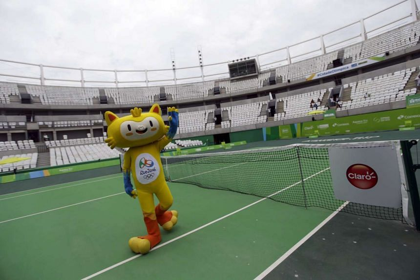 Rio 2016 Olympic mascot Vinicius greets the audience during the inauguration of the Rio 2016 Olympic Games Tennis Center in Rio de Janeiro, Brazil on Dec 12, 2015.