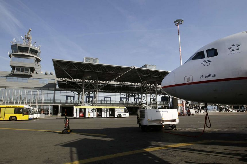 Greece's leftist government on Monday signed its first big privatisation deal with German airport operator Fraport, awarding it a 1.2 billion euro contract to lease and manage 14 regional airports.