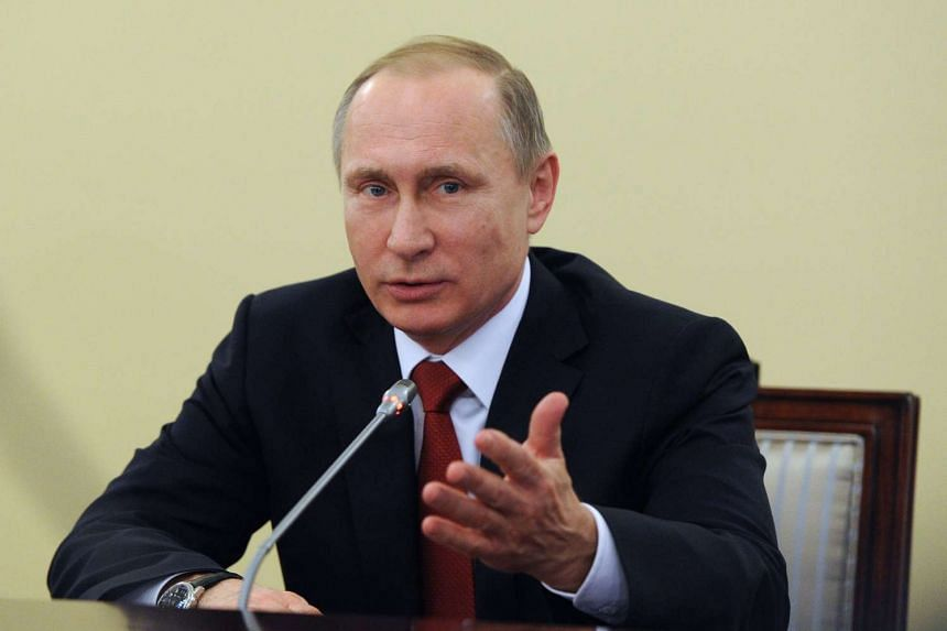 Russian President Vladimir Putin speaks during a meeting with Russia's Constitutional Court judges on Dec 14, 2015.