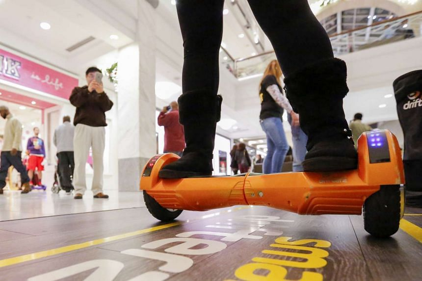 Shoppers view a sales person on a hover board at the Lenox Square Mall in Atlanta, Georgia, USA.