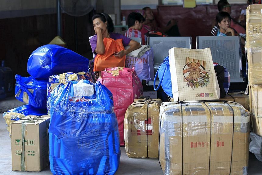 Stranded passengers wait inside a bus terminal in Pasay city, Manila on Dec 14, 2015.