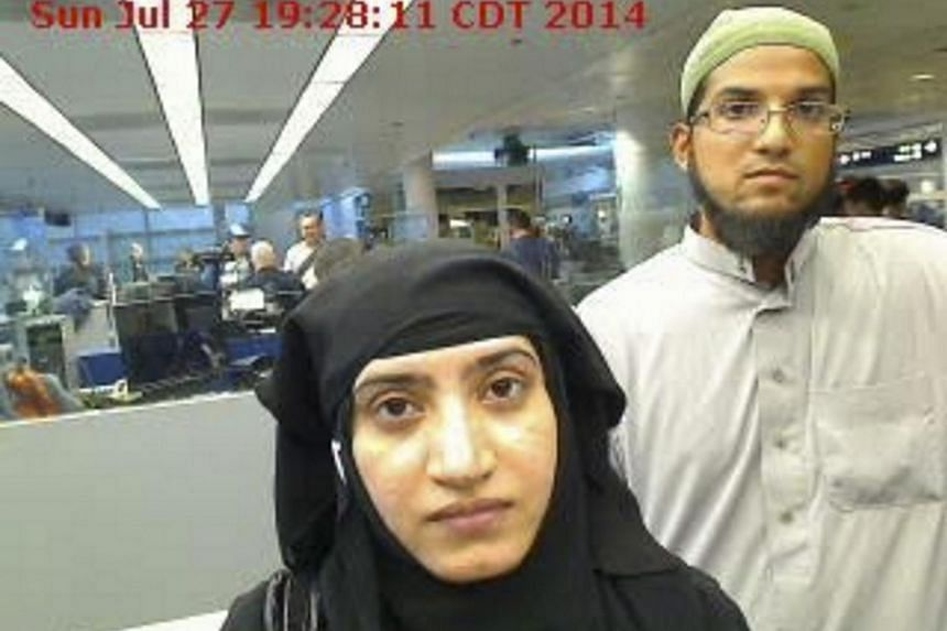Tashfeen Malik (left) and Syed Farook pictured passing through Chicago's O'Hare International Airport in this Jul 27, 2014, file photo.
