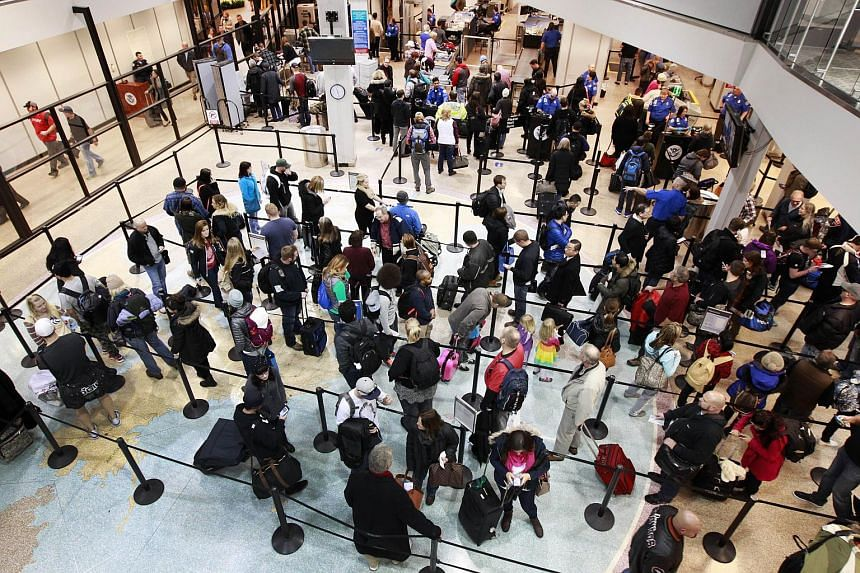 Travelers wait in line to go through security at the Salt Lake City International Airport on Dec 14, 2015.