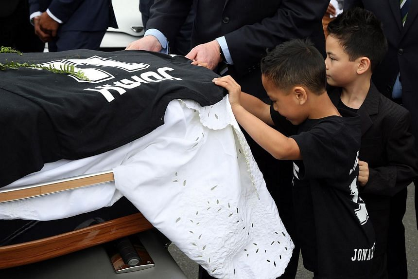 (From right) Brayley and Dhyreille Lomu, sons of late New Zealand rugby legend Jonah Lomu, helping to load their father's casket into a hearse following a funeral service in Auckland on Dec 1.
