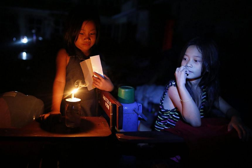 Filipino children rest inside a school turned into a temporary evacuation centre in the town of Daraga, southern Manila.