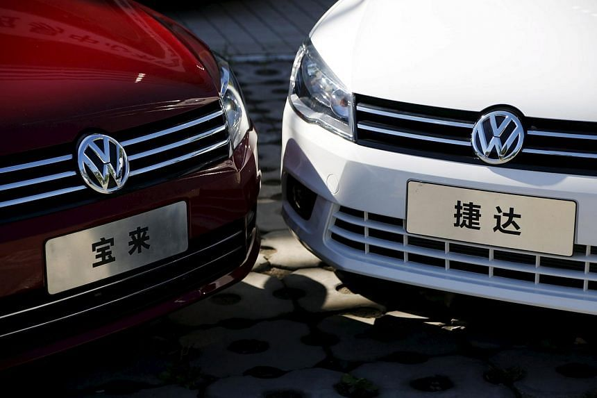 Volkswagen's Bora and Jetta models are displayed outside a dealer in Beijing on Oct 1.