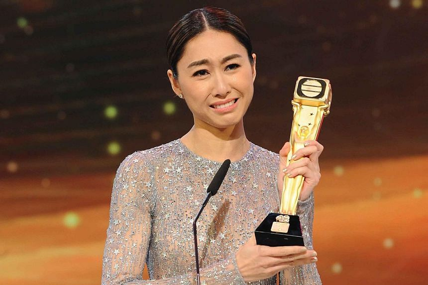 Anthony Wong accepting the Best Actor award, with actresses Linda Chung and Kristal Tin as presenters. A stunned and weeping Nancy Wu (above) with her Best Actress trophy.