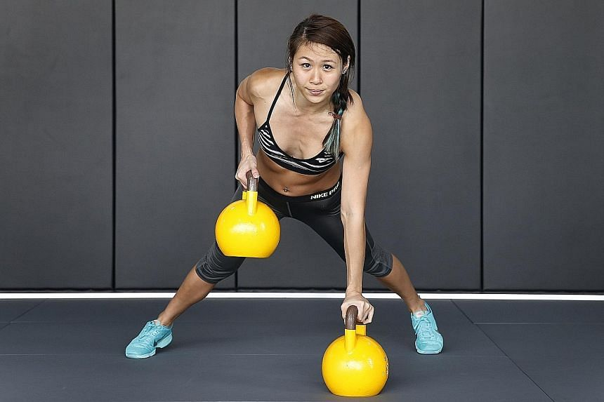 Ms Georgina Poh loves the rush of endorphins after a workout, and enjoys pushing herself to lift heavier weights.