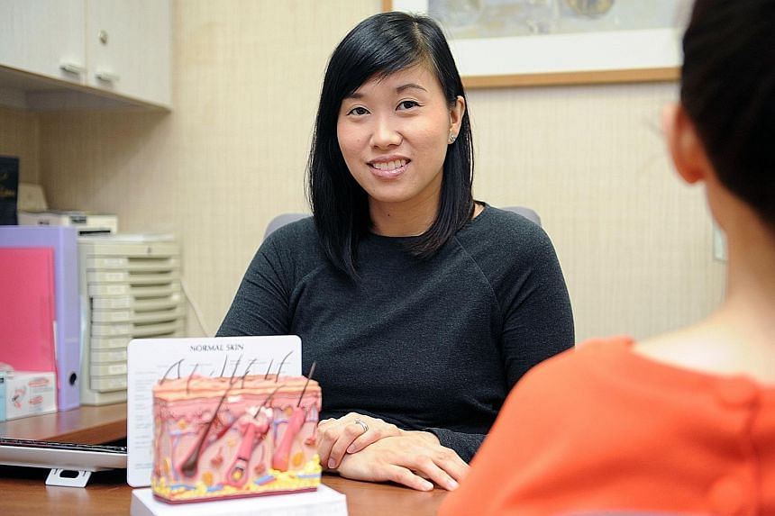 Dr Rachael Teo feels her work is often like an artist's, as her diagnoses rely heavily on her ability to correctly assess shape, colour and texture when examining a patient's skin for conditions such as acne or eczema and even signs of cancer.