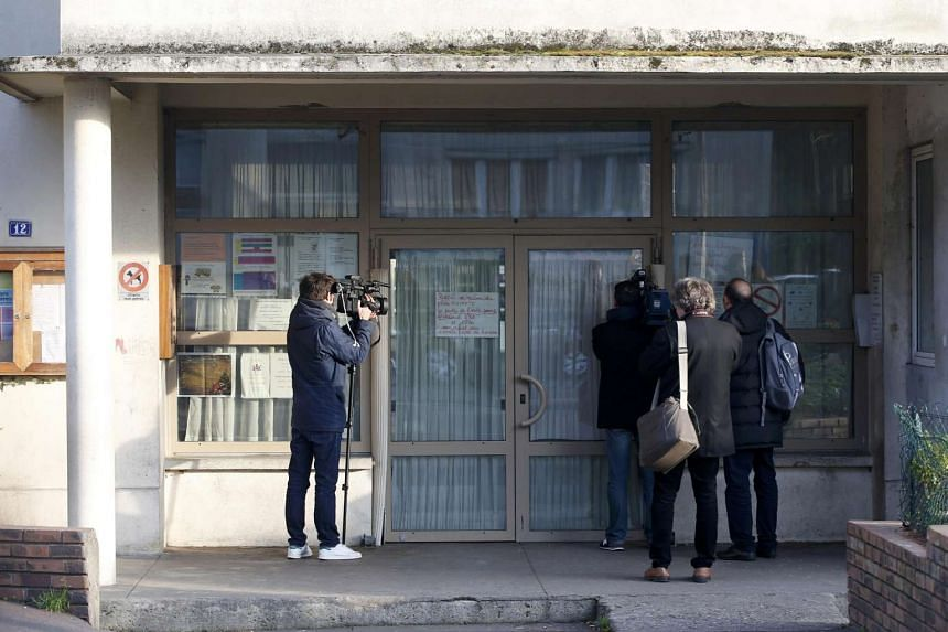Journalists at the entrance of the nursery school where a hooded man claiming to be acting for Islamic State attacked a teacher with a knife in Aubervilliers, near Paris, France, on Dec 14, 2015.