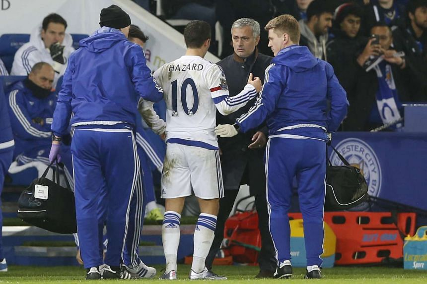 Chelsea's Eden Hazard (in white) goes off injured as he talks to manager Jose Mourinho (second from left).
