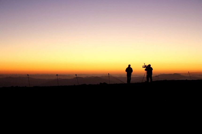 Members of the media work during the opening ceremony of The Giant Magellan Telescope (GMT)  near Vallenar town, Chile on Nov 11.