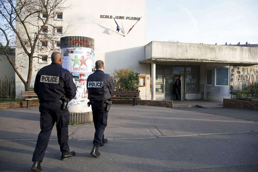 French police stand outside the nursery school on Dec 14, 2015.