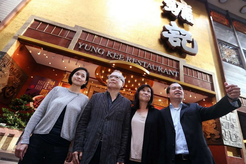 Yung Kee founder's son Ronald Kam (left, in grey) with his daughter Yvonne, sister Mei Ling and son Carrel. Ronald's family and that of his late brother Kinsen have been ordered by the courts to reach an agreement over their competing stakes in the roast