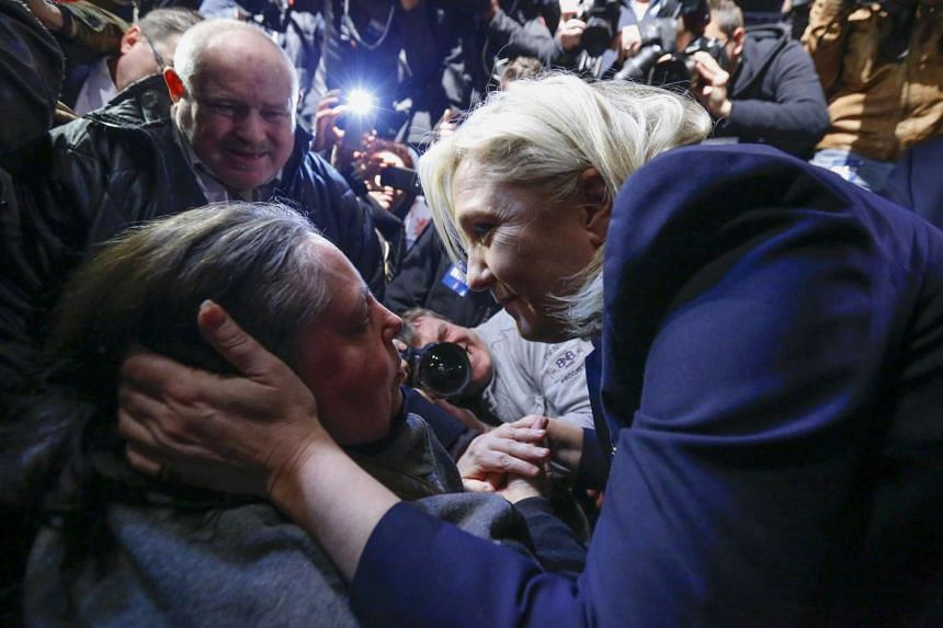 Ms Marine Le Pen (at right), National Front leader and candidate in the Nord-Pas-de-Calais-Picardie region, with supporters after results in the second round of regional elections in Henin-Beaumont, France, on Sunday. She condemned the concerted camp