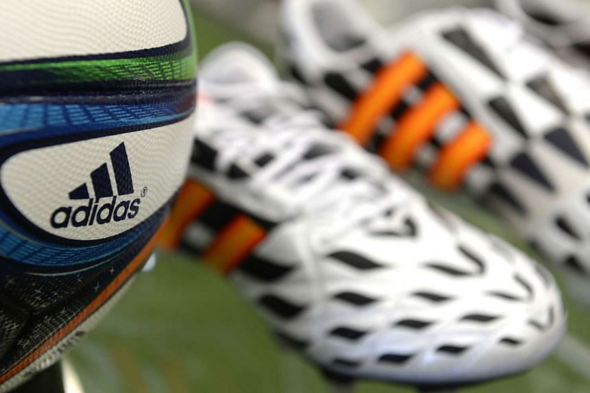 The official FIFA football World Cup ball and a pair of shoes in the Adidas headquarters.