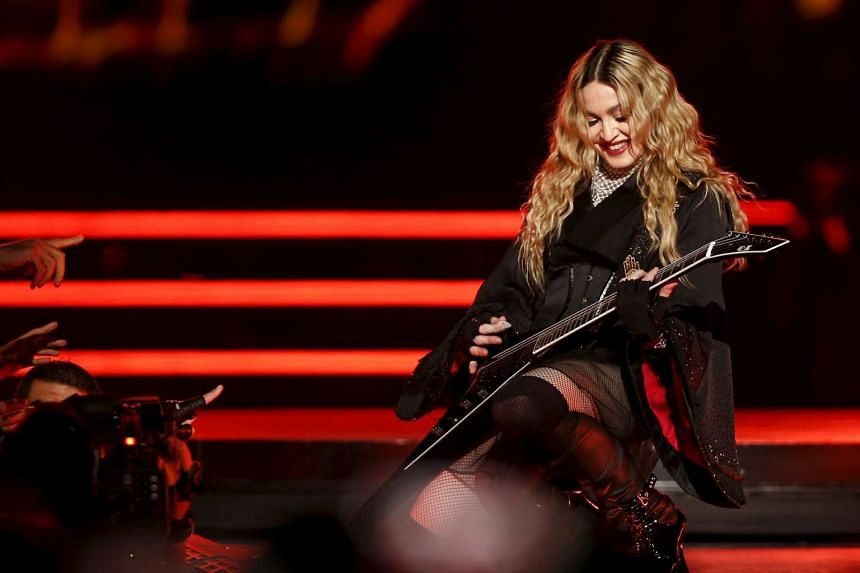 Madonna performs during her concert at the AccorHotels arena in Paris on Dec 9, 2015.