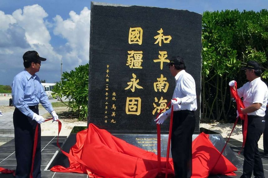 Taiwan's Interior Minister Chen Wei Zen (centre) unveiling a stone tablet claiming Taiwan's sovereignty on the Taiping Island in the South China Sea on Dec 12, 2015.