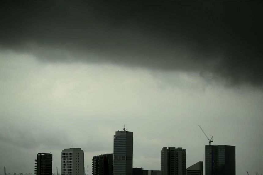 Dark clouds loom above buildings in the Alexandra area as seen from Mount Faber on Dec 13, 2015