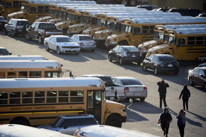 Los Angeles Unified school district buses and drivers sit idle following a credible threat in Los Angeles on Dec 15, 2015.