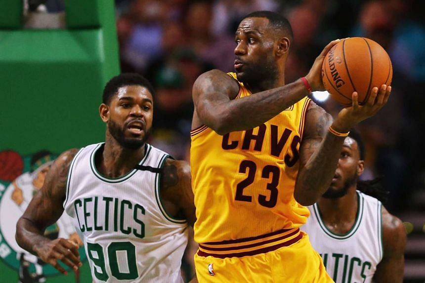 Cleveland Cavaliers' LeBron James (right) in action against Amir Johnson of the Boston Celtics.